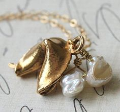 Reminds me of the sweet gold fortune cookie necklace I wore in the early 80s. I still have it. This one is even cuter and I love that its more organic looking.