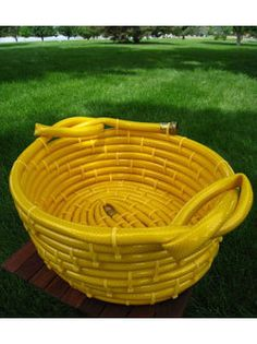 For all those leaky hoses! Yellow Garden Hose Basket by Chase Forest Garden Crafts, Garden Projects, The Family Handyman, Outdoor Projects, Outdoor Decor, Outdoor Furniture, Recycled Garden, Garden Items, Basket Weaving