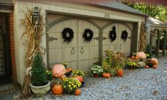 autumn outdoor decorating...pumpkins and mums and planters