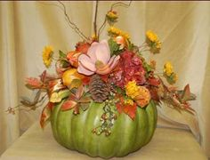 fall pumpkin flower arrangements   Excellent as a centerpiece, this large green pumpkin is topped with ...