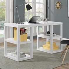 This Desk features 2 storage cubbies on each side to hold all your office necessities. The large smooth desk top has plenty of room for your laptop, lamp and office supplies. The crisp white finish an