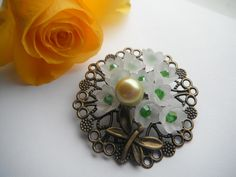 Brooch or Badge Pale Flowers and a Butterfly £8.50
