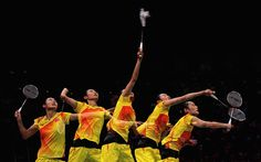 Yihan Wang of China makes a serve in her badminton gold medal match...