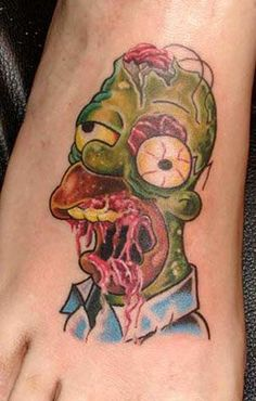 It's none other than everybody's lovable character Homer Simpson with a slightly different avatar. Zombie Homer Simpson Tattoo: Homer's Finally Been Inked! Zombie Tattoos, Nerdy Tattoos, Cartoon Tattoos, Funny Tattoos, Fake Tattoos, Body Art Tattoos, Tattoos For Guys, Sleeve Tattoos, Cool Tattoos