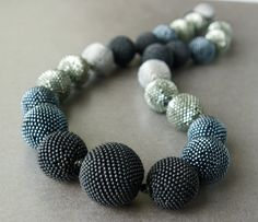 LOTS of work, and very tiny seed beads in this beaded bead necklace!