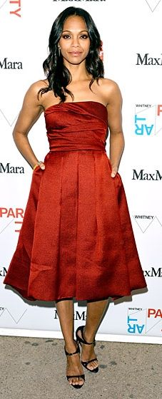 Zoe Saldana looks ravishing in a red strapless dress by Max Mara at the Whitney Art Party
