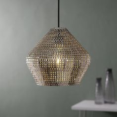 This unique, hand crafted, crown style pendant serves as a beautiful source of light and a statement piece for your home. It's unique design complements a variety of home décor; whether you're going for a boho, Moroccan, or eclectic style, this piece is sure to be an eye-catcher. Hang it above your dining table for a conversation starter, in the bedroom for some additional fun decor, or in the entryway for some added style.