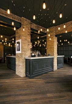 Alice House – West Hampstead  Project for the Urban Leisure Group. WOOD FLOOR/BLACK BAR AND LIGHT BRICK
