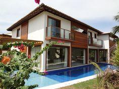 Residência de Praia: Casas rústicas por Tupinanquim Arquitetura Brasilis