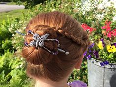 Gorgeous!  Butterfly flexi hair clip holding a bun with side braid accent.