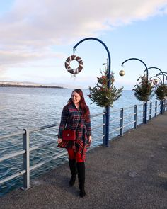 CHLOE.ROXANE - Style : A Christmas outfit that is perfect to celebrate with the family. A blue and red tartan dress, red tights and a festive Night&Day bag by De Marquet is all I need for Christmas! I'm also loving how festive Morges, Switzerland looks with all its lovely Christmas trees.