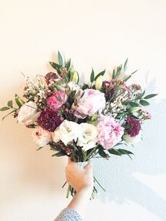 Pink fun and flirty wedding bouquet with Peonies, scabiosa, Lisianthus, olive branch, and Italian ruscus!