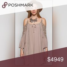The Jenna Collection Mocha Cold Shoulder Dress 🎉Host Pick- Everyday Essentials🎉 Flirty and girly! This Jenna Collection is the picture of sophisticated ease. The dress features long sleeves with cold shoulders. The sleeves and front have stylish crocheted designs. It pairs perfectly with boots and a pumpkin spice latte! NEW Boutique Dresses