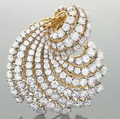 "Van Cleef & Arpels Mid-20th Century Diamond, Platinum and Gold ""Swirl"" Brooch, circa 1965.  Macklowe Gallery."