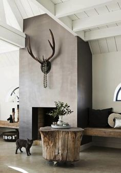 love the uber modern fireplace with white painted beam ceiling.