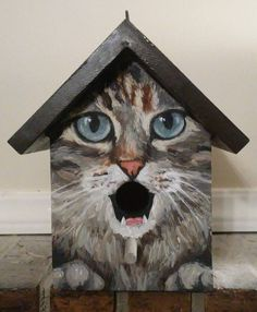 This bird house is a hand painted EXAMPLE of a grey tabby cat with blue eyes. Each birdhouse is one of a kind. Custom orders of various cat breeds are welcome. Makes a great gift for the cat lover! Hand painted wood with acrylics and sealed with se Bird Houses Painted, Bird Houses Diy, Painted Birdhouses, Bird House Plans, Bird House Kits, House Painting, Painting On Wood, Grey Tabby Cats, Birdhouse Designs