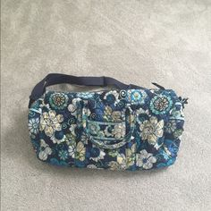 Vera Bradley Duffel Bag Blue paisley Vera Bradley duffel bag in a beautiful discontinued pattern. Slight wear marks on the handles, otherwise in great condition! Vera Bradley Bags Travel Bags