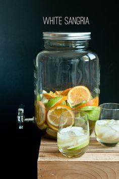 Recipe:   2 bottles white wine (Riesling)   1/2 liter ginger ale   3 oranges (juiced & sliced)   2 lemons (juiced & sliced)   1 lime...