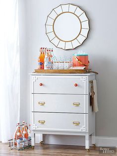 With ample drawers for linens and extra glasses, plus a flat top, a dresser is perfect for becoming a bar cart. One blogger turned a basic IKEA dresser into a wow-worthy statement piece. Start by painting the drawers and body of the dresser -- she used Benjamin Moore Wickham Gray. Then install decorative accents, like a gold-spray-painted towel rack, chic overlays, and bold hardware. Get the full how-to tutorial here, plus meet the blogger behind the design on the next slide.