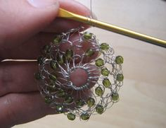 Wrap the wire end around your hook 3 or 4 times to make a ring.