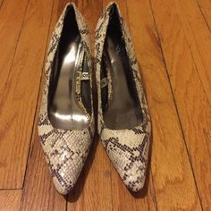 Faux snakeskin pump. Pointy toes pump from Merona. Faux snakeskin. Only worn a couple of time. Heel is about 2.5 inches. Merona Shoes Heels