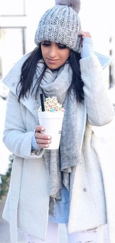#winter #outfits blue sweater, white jeans, white coat, grey hat, scarf
