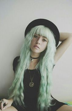 Pastel green hair - pastels like this are a fun way to accentuate light blonde hair...