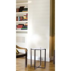 Slightly art-deco styled, the Lens accent table's a real modern classic in its own right. The transparent round glass top and dual-framed support in satin bronze will fit quite well with just about any room decor.