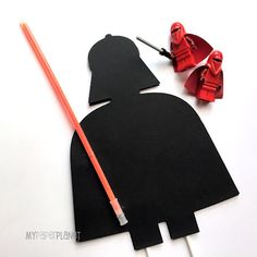 Darth Vader cake topper with glow stick lightsaber.   by My Paper Planet