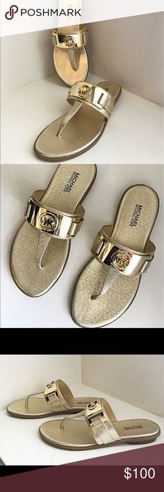 Michael Kors Gold Metal Thongs NIB Gorgeous gold Michael Kors Thongs beautifully Embellished with a gold metal plate engraved and cut out with MK logo.   These shoes are sure to be you favorites.  Dress them up or down.  Ladies size 5B.  Sorry no lid to box. Michael Kors Shoes Sandals
