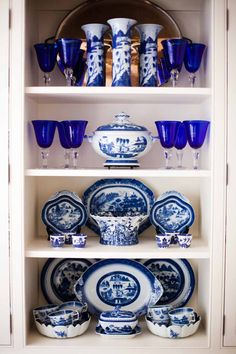 cobalt blue stemware mixed with blue wilow & other cobalt & white china