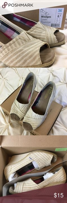 Peep Toe Linen Pinstripe Wedges Pretty pink plaid lining inside with a wrapped wedge in a classy cream/beige pinstripe for spring/summer! Great used condition with the original box. There are some spots you can see in the photos with yellowing and the heels of the soles have worn a bit. Toms Shoes Wedges