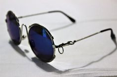 Sunglasses design recalls Jean Paul Gaultier, Matsuda , Vintage Round