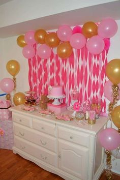 Pretty balloon and crepe paper backdrop at a Pink and gold girl birthday party ! See more party planning ideas at CatchMyParty.com!