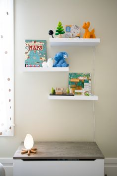 Campfire Nightlight from Land of Nod, Machi City Playset from Kiko Kids, Green Keys Teether from Begin Again, Spoka Nightlights from Ikea, Plush Elephant from Jellycat, Stacking Tree from Plan Toys, Balloon Animal Bookend from IMM Living, and assorted books