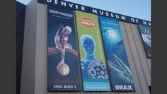 Exterior building banners for the revolving exhibits for the Denver Museum of Nature and Science