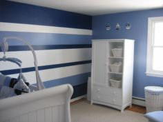 "Nautica Nursery, My husband loves sailboats so the perfect nursery for our new son included the bedding set ""William"" from Nautica. I used the colors from the set to do an accent wall in vertical stripes. Very time consuming but very worth it., , Nurseries Design"