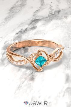 With an elegant contoured band, sparkling accents and center princess-cut gemstone, this glittering ring is truly one of a kind. Personalize it in silver, white, yellow or rose gold with your choice of birthstone. With free shipping, free resizing and a free bonus gift, it's the perfect gift for you or someone you love.
