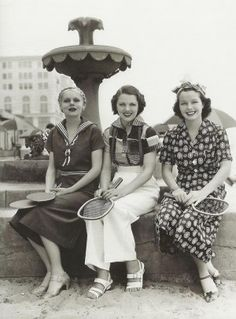 1936 Ladies ready to play tennis in coulette, pants and pant set.