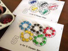 Olympic Craft idea for kids: color in Olympic ring printables or if you're feeling nice...let them use M&Ms.