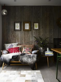 8. Get Industrial: Exposed brick walls, concrete floors and visible plumbing give a modern, industrial look, while adding warm woods and cozy, woven blankets bring a warm, inviting feel.--20 Glam Ways to Add Texture to Your Home via Brit + Co.