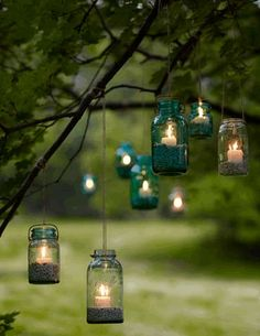 Mason Jar Candle Holders Hung From Tree Branches