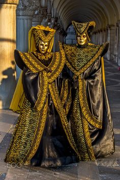 "Venice-Carnival - #77 - Theses models are posing at Doge's Palace, San Marcos Square shortly after sunrise.    Their costumes have a ""dark"" look to them, but are very elaborate.  Carnival, Venice, Italy."