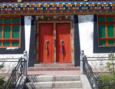 Red doors in China are related to the practice of Feng Shui. Painting your door red allows the energy to enter your home.