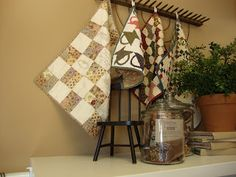 decorating with quilts - miniature quilts displayed on an old rake