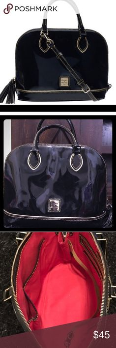 Dooney & Bourke patented leather black purse Patent leather black Dooney & Bourne purse, gently used. Bought off another posher just a purple months ago. One of the tassels on the zipper is missing but you can't really notice, price reflects this. Let me know if you have any questions! Dooney & Bourke Bags Satchels