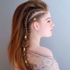 Braided Warrior: Hello, gorgeous! This hairstyle has warrior princess written all over it. Let your braids shine by adding gold rings and mega volume to the look.