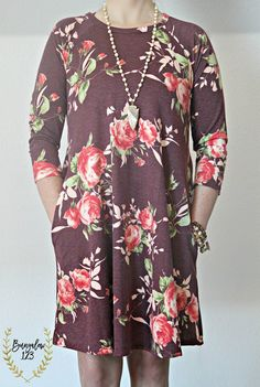 Gorgeous Floral Dress in Burgundy featuring a vintage floral motif throughout. Ultra-soft material with an A-line fit. Two side pockets. Looks great with a pair of our B123 Seamless Leggings underneat