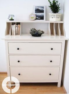 Use wood magazine holders to create the shelf on top of dresser.