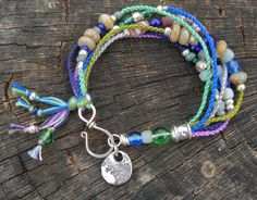 """Seaside Breeze"" bracelet with pewter charm by Mamacita Beadworks colorful hand-knotted cotton cords strung with jasper discs, African trade beads, Czech glass and Indo-pacific beads.    https://www.facebook.com/BlueQuailDesign"
